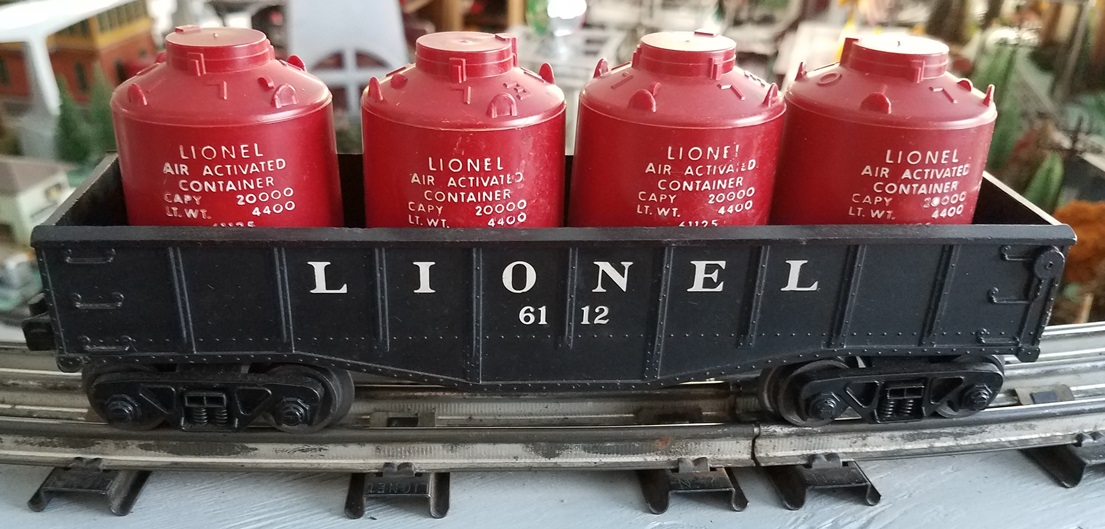 Lionel Postwar 6112-1 black gondola with canisters