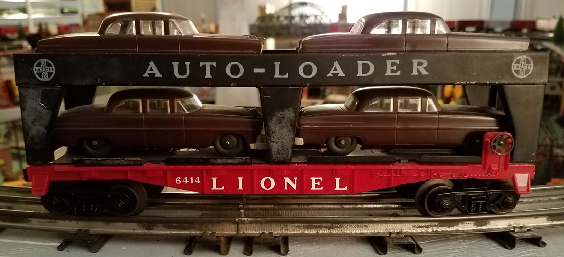 Lionel Postwar 6414 Evans Auto-Loader with brown automobiles