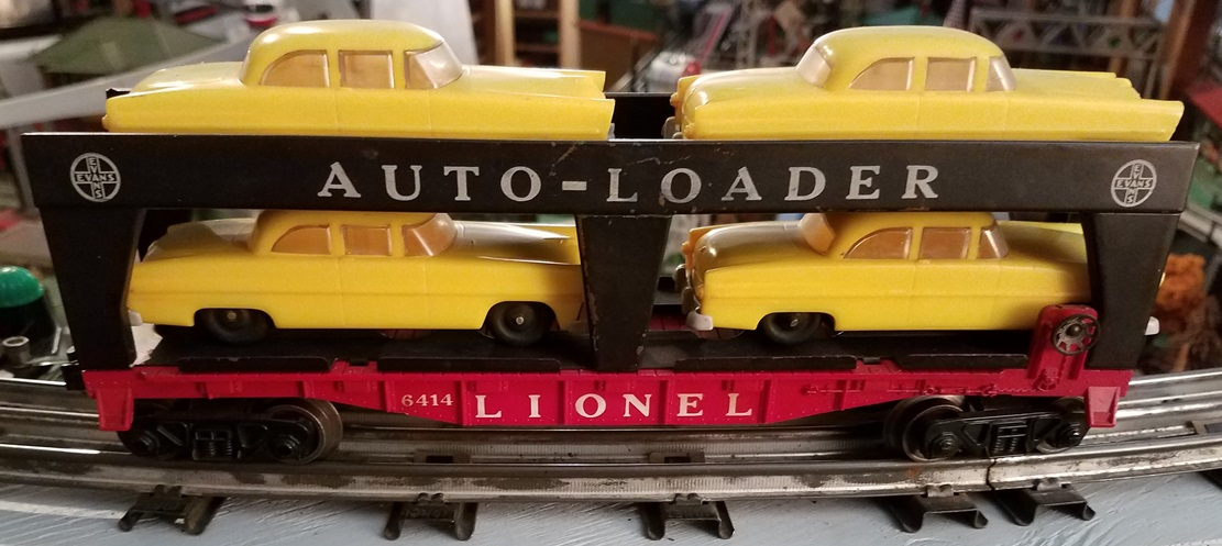Lionel Postwar 6414 Evans Auto-Loader with yellow automobiles