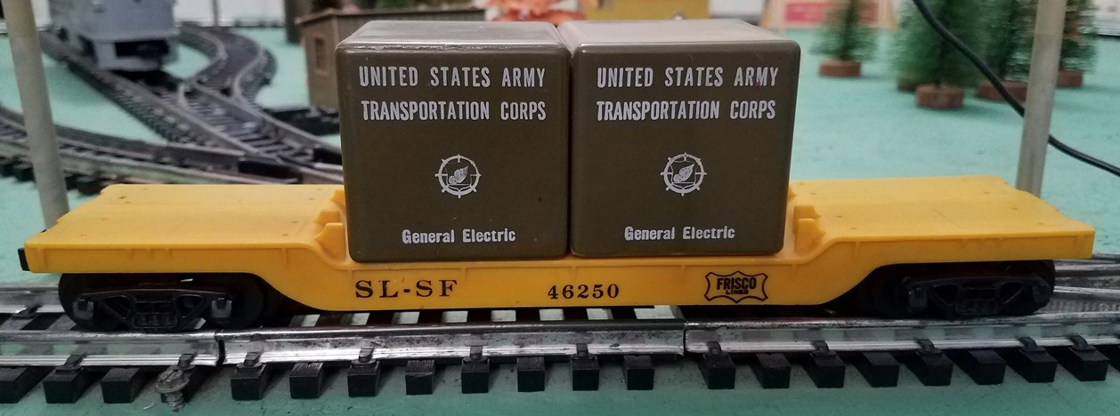 Frisco drop center flatcar with green cases