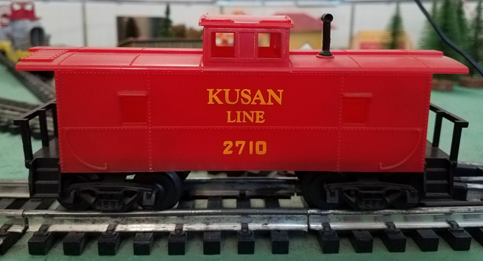 Kusan Line red caboose with yellow letters