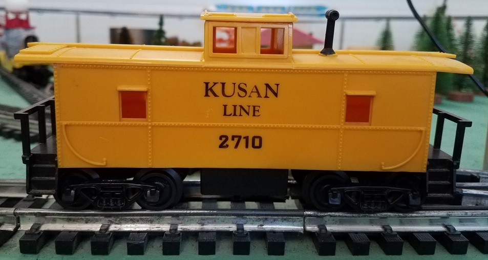 Kusan Line yellow caboose with black letters