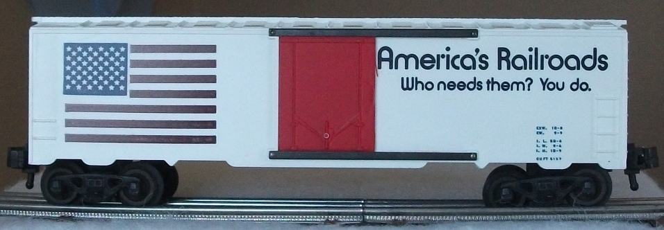 Kris America's Railroads white boxcar with black and blue lettering and red plug doors