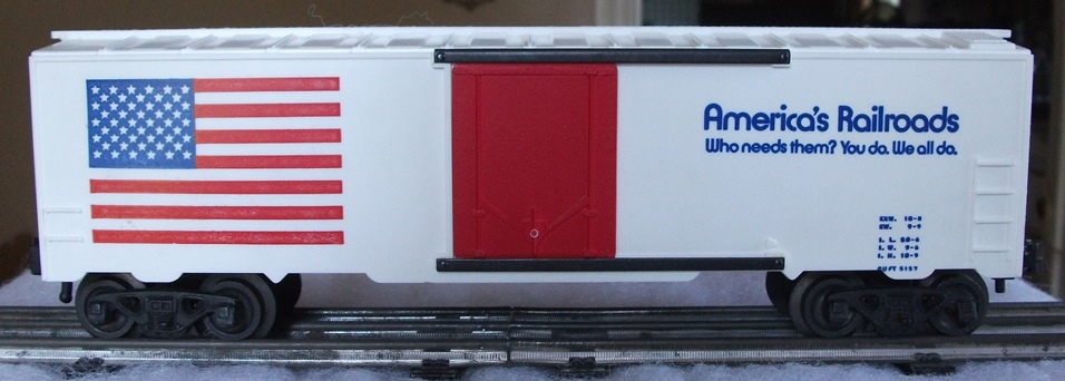 Kris America's Railroads white boxcar with blue lettering and red plug doors