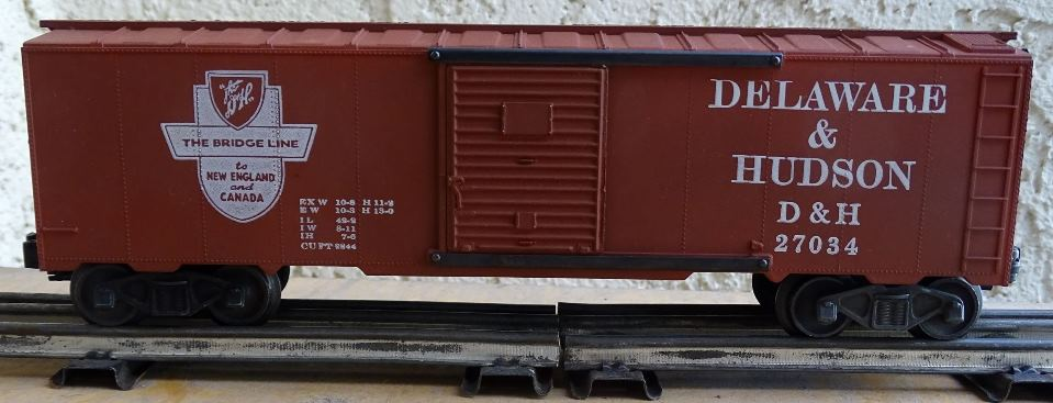 Kris Delaware and Hudson 27034 boxcar red boxcar with logo on the left