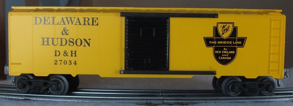 Kris Delaware and Hudson 27034 yellow boxcar with black doors