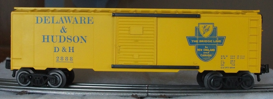 Kris Delaware and Hudson 2888 yellow boxcar with yellow doors