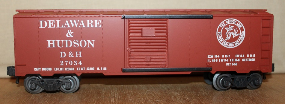 Kris Delaware and Hudson 27034 boxcar red boxcar with logo on the right