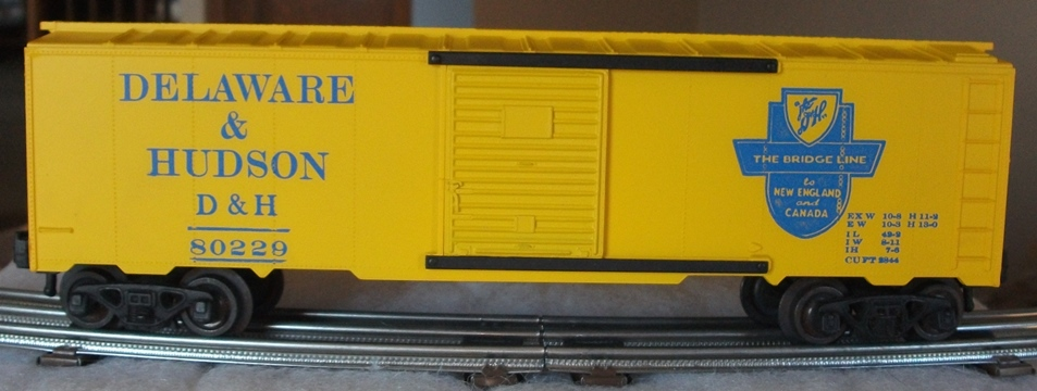 Kris Delaware and Hudson 80229 yellow boxcar with blue lettering