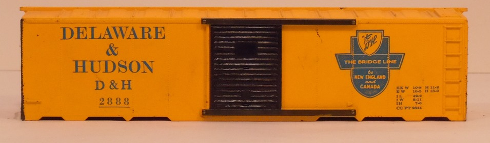 Kris Delaware and Hudson 2888 yellow boxcar with black doors