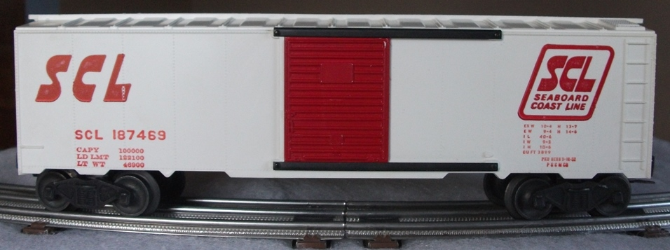 Kris Seaboard Coast Line 187469 white boxcar with red panel doors and full ladders