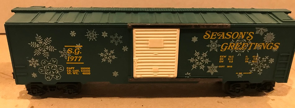 Kris 1977 Season's Greetings green boxcar with yellow lettering
