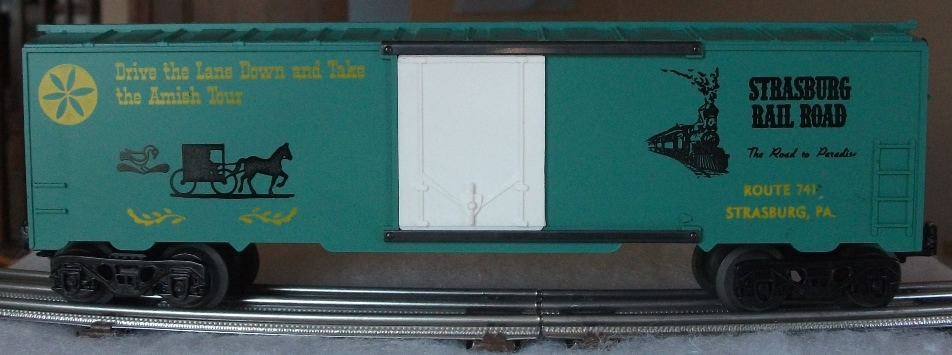 Kris Strasburg Rail Road green boxcar with yellow letters and plug doors