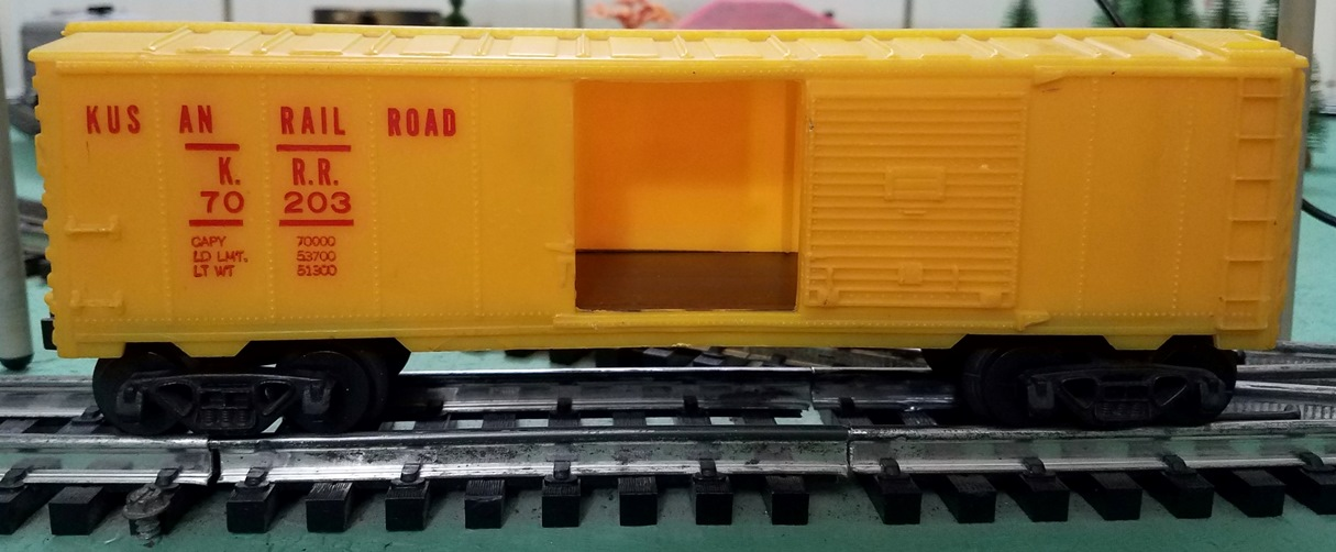 Kusan Railroad yellow boxcar