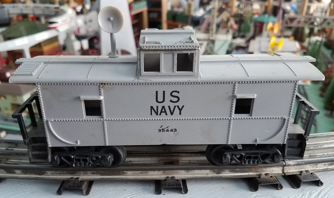 US Navy caboose with gray radar antenna