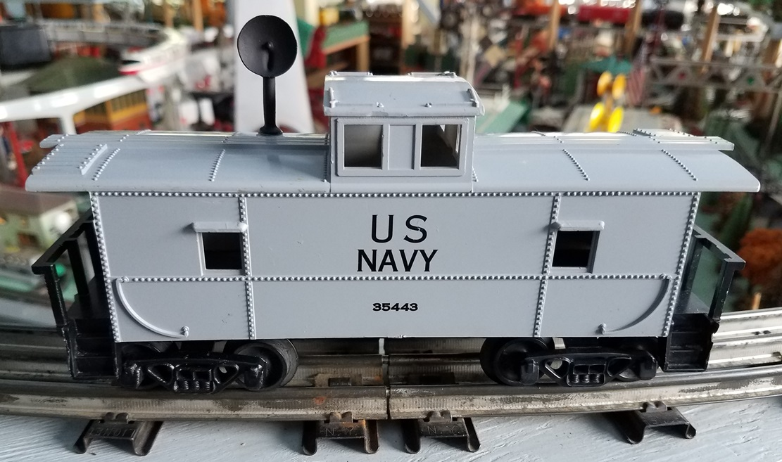 US Navy caboose with black radar antenna