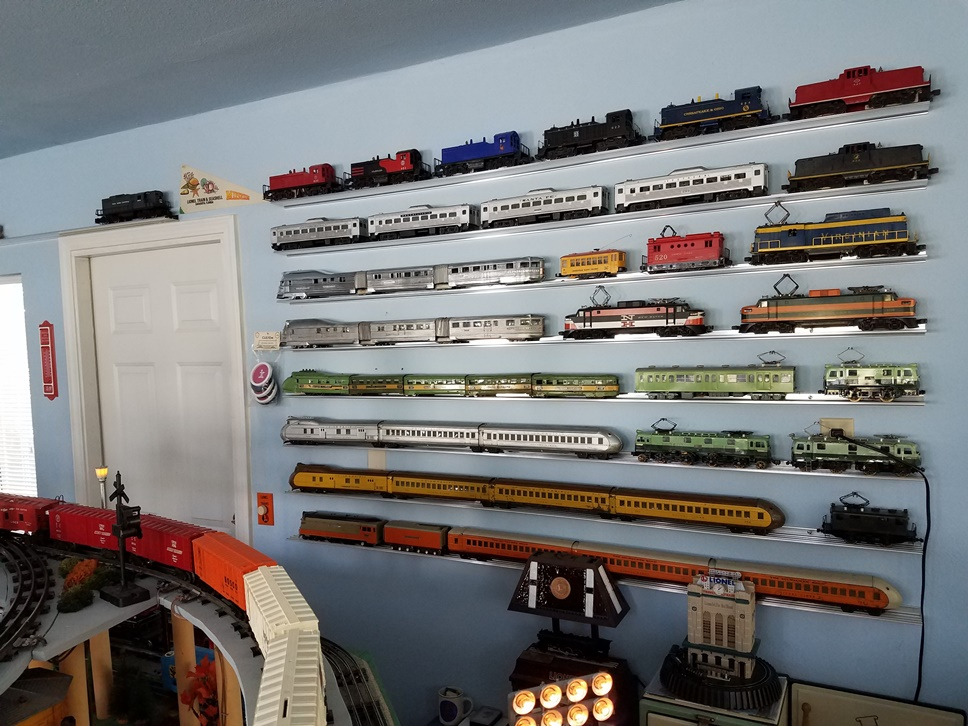 Train display shelving on the north wall