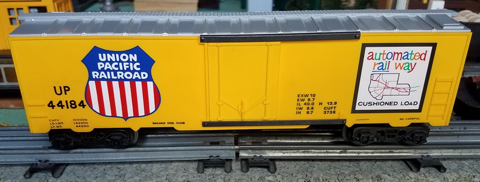 Kris Union Pacific 44184 yellow and silver boxcar with yellow plug doors and extra car data