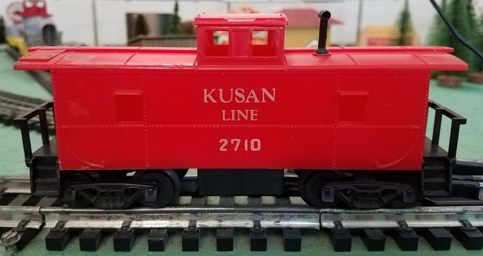 Kusan Line red caboose with white letters