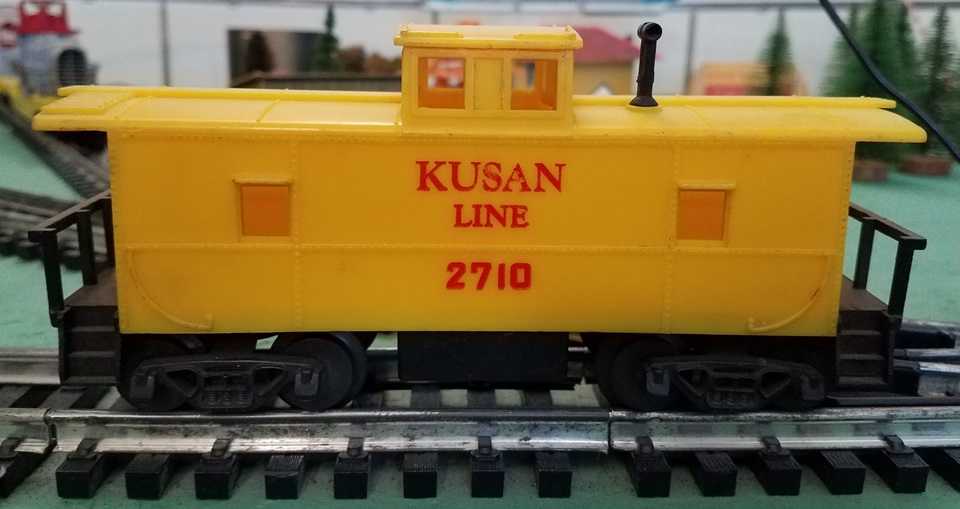 Kusan Line yellow caboose with red letters