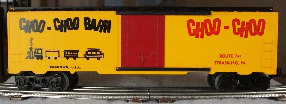 Kris Choo-Choo Barn yellow and black boxcar with train logo and red plug doors