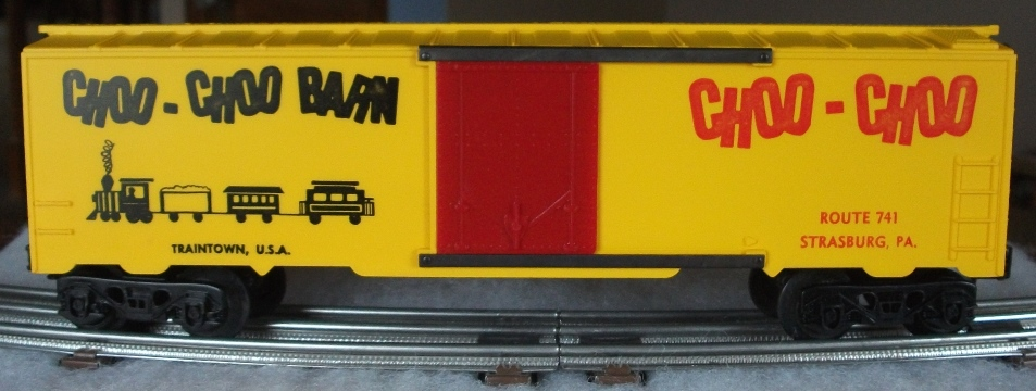 Kris Choo-Choo Barn yellow boxcar with train logo and red plug doors