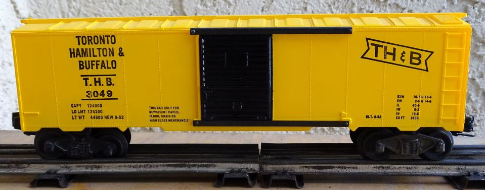 Kris Toronto, Hamilton and Buffalo bright yellow boxcar with full ladders