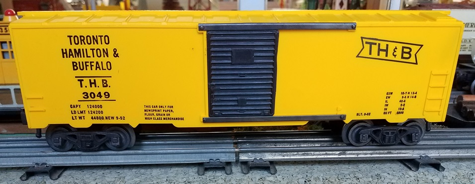 Kris Toronto, Hamilton and Buffalo bright yellow boxcar with half ladders