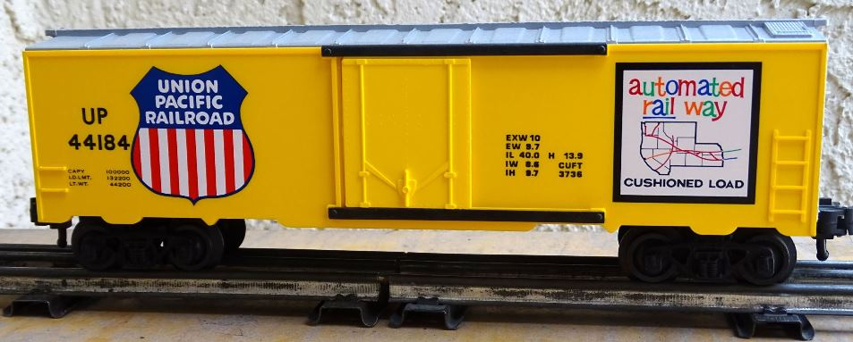 Kris Union Pacific 44184 yellow and silver boxcar with yellow plug doors and less car data